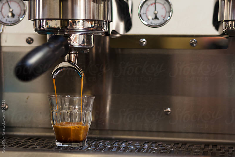 Double espresso pouring by Reece McMillan for Stocksy United