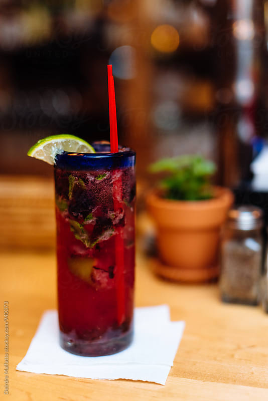 blueberry mojito at a bar by Deirdre Malfatto for Stocksy United