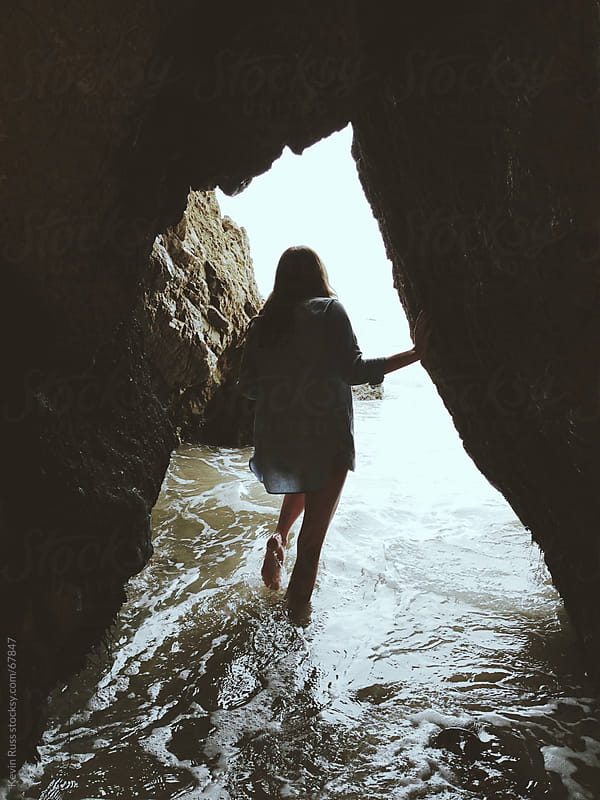Woman Exploring a Sea Cave by Kevin Russ for Stocksy United