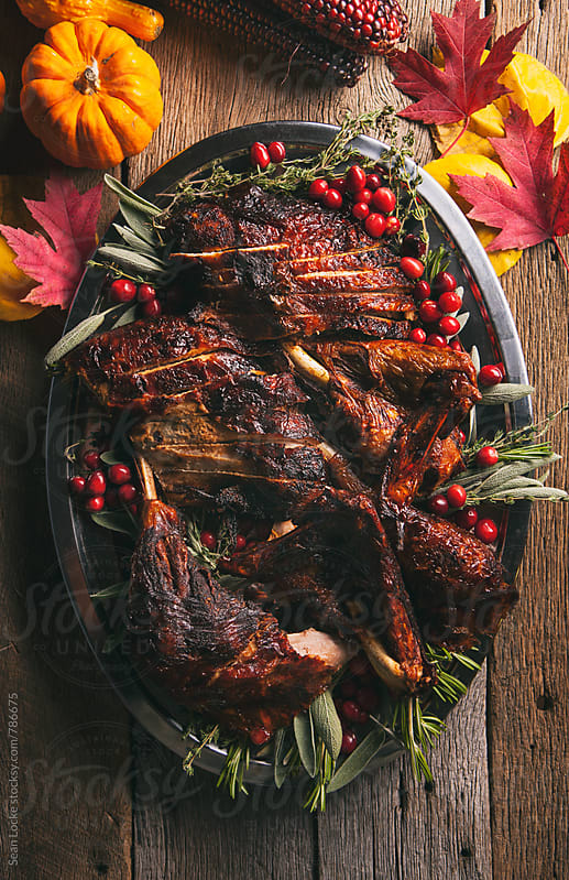 Thanksgiving: Sliced Up Deep Fried Turkey With Autumn Decorations by Sean Locke for Stocksy United