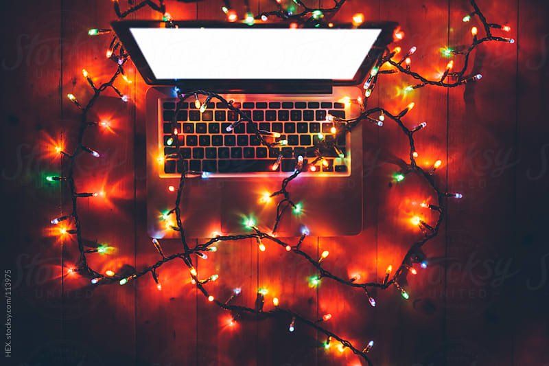 Laptop With Christmas Lights by HEX. for Stocksy United
