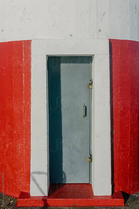 Grey Door Lighthouse  by HEX. for Stocksy United