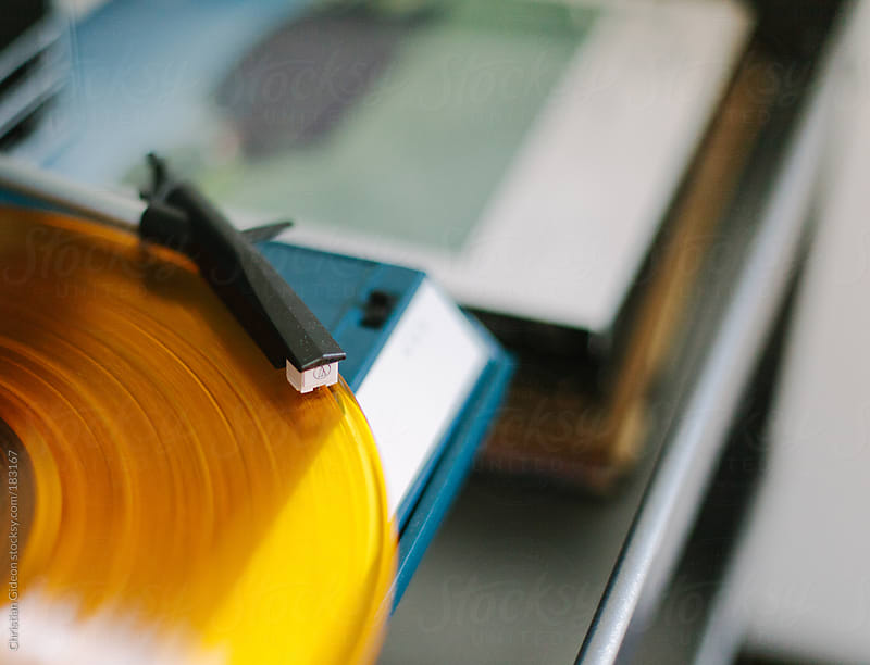 Yellow Record on Record Player by Christian Gideon for Stocksy United
