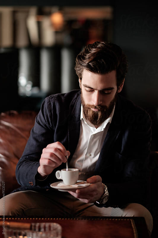 Handsome Bearded Man Drinking Coffee by Branislav Jovanović for Stocksy United