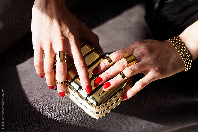 Elegant Woman's Hands on Golden Purse by Eldad Carin for Stocksy United