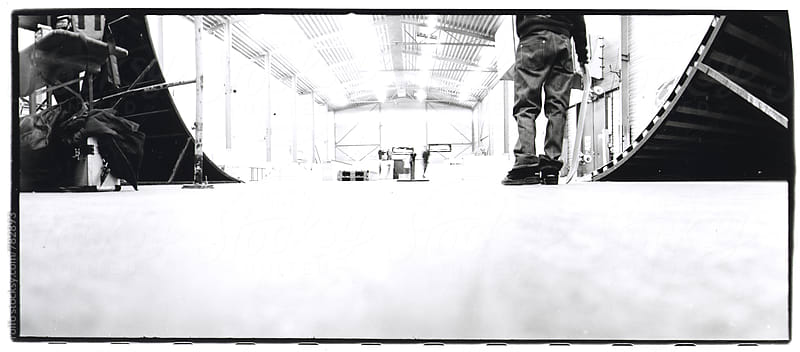skateboarder in a skatehall by rolfo for Stocksy United
