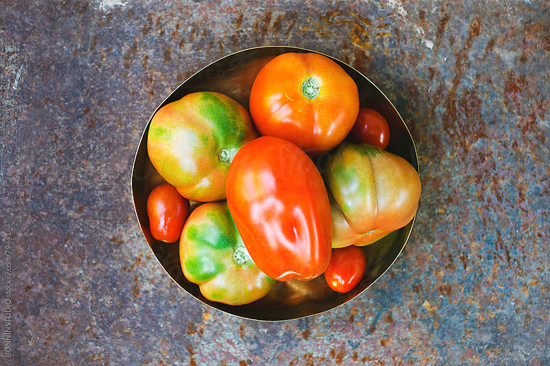 Variety of organic tomatoes on a bowl. by BONNINSTUDIO for Stocksy United