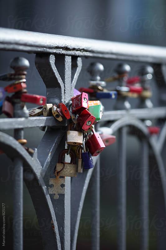 Love locks on the railing of a bridge by Marcel for Stocksy United