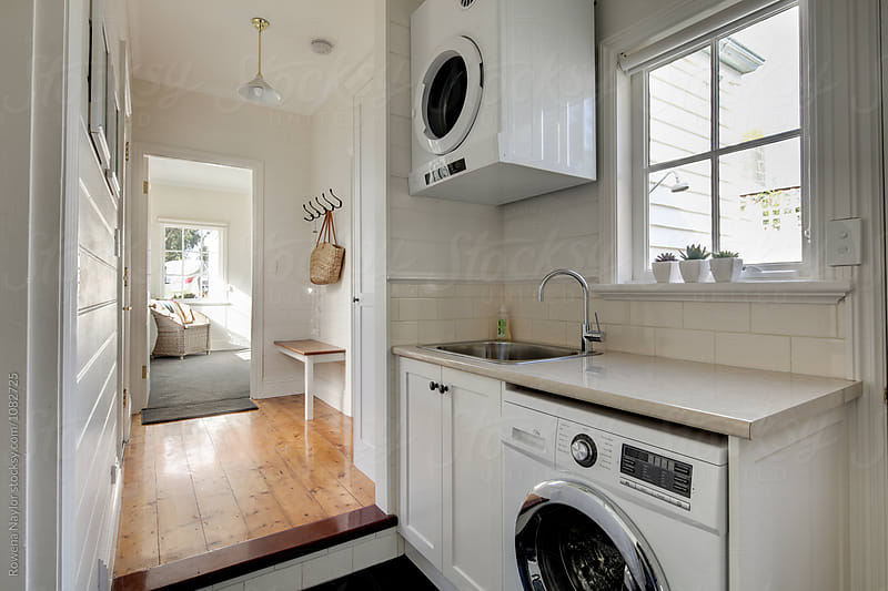 Laundry space in small cottage by Rowena Naylor for Stocksy United