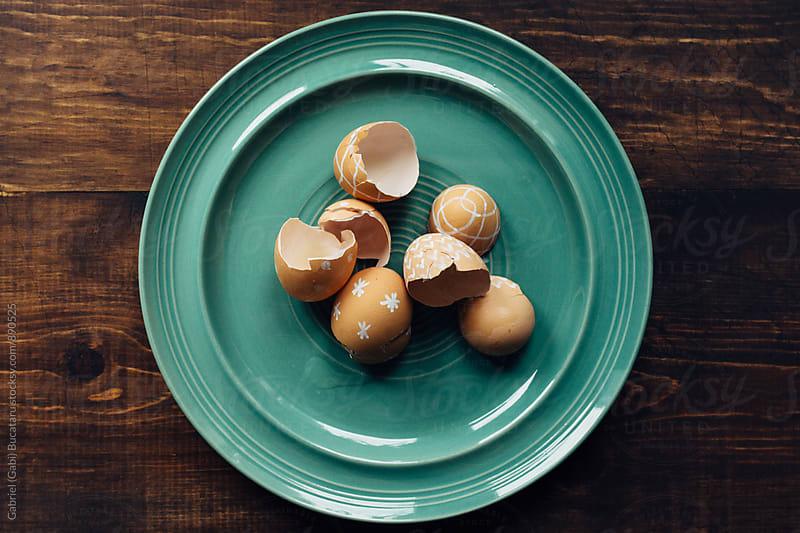 Decorated brown egg shells in a plate by Gabriel (Gabi) Bucataru for Stocksy United