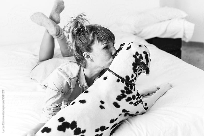 Young woman with a dalmatian dog by Lucas Ottone for Stocksy United