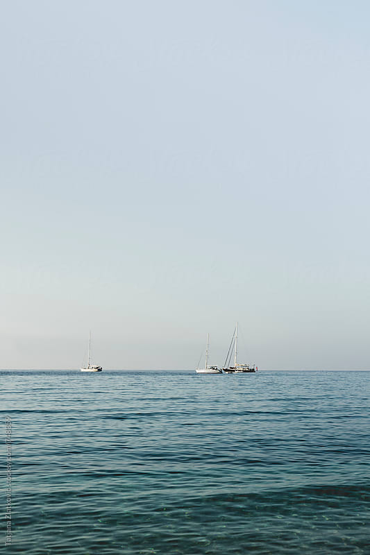 Sailboats on the sea by Tatjana Ristanic for Stocksy United
