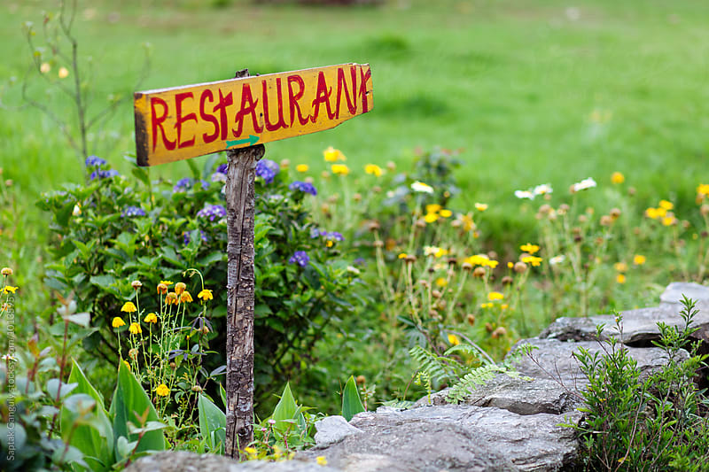 Handmade restaurant sign outside a rural restaurant by Saptak Ganguly for Stocksy United