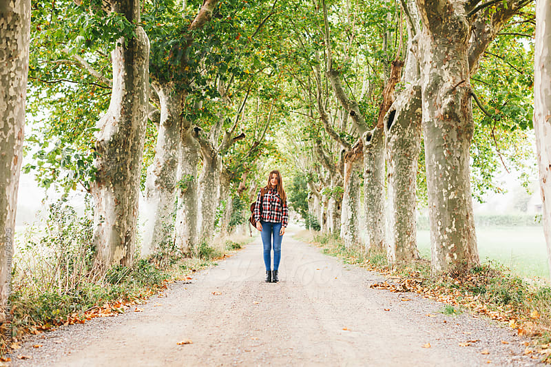Teen girl standing on a forest path in autumn. by BONNINSTUDIO for Stocksy United