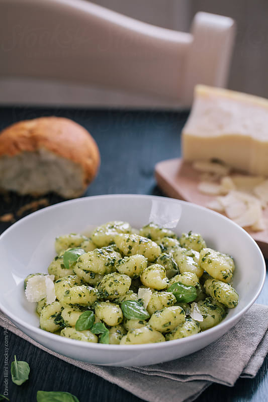 Gnocchi with pesto sauce. by Davide Illini for Stocksy United