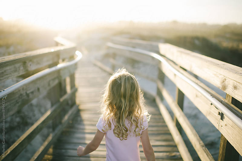 Girl on Boardwalk by Michelle Gardella for Stocksy United