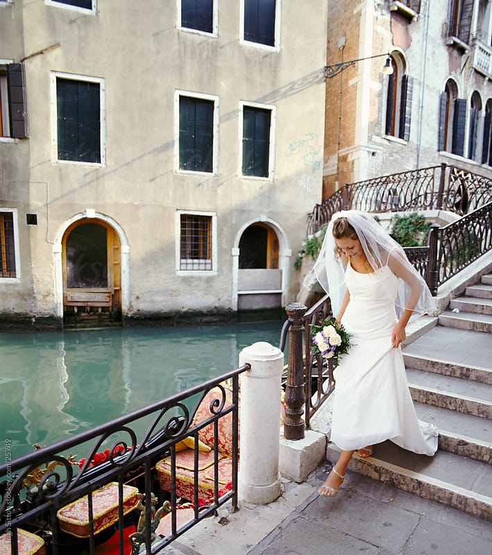 Bride by one of the many Venice canals. Venice. Italy. by Hugh Sitton for Stocksy United
