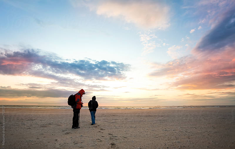 People standing on a North Sea beach. by Mosuno for Stocksy United