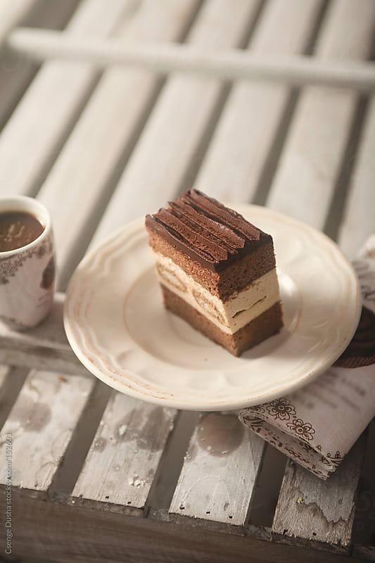Tiramisu cake slice by Csenge Dusha for Stocksy United