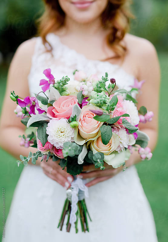Bride with bouquet by Milles Studio for Stocksy United