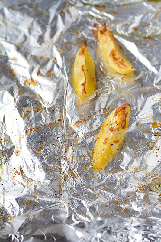 Leftover baked potato wedges by Noemi Hauser for Stocksy United