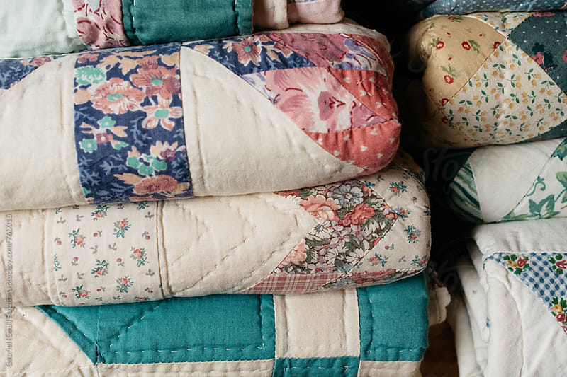 Old-fashioned folded quilts by Gabriel (Gabi) Bucataru for Stocksy United