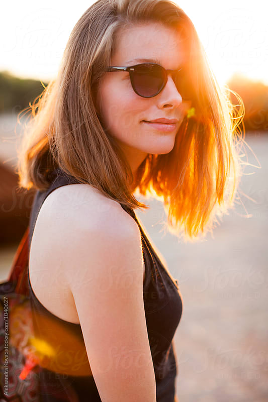 Beautiful woman portrait at sunset by Aleksandra Kovac for Stocksy United