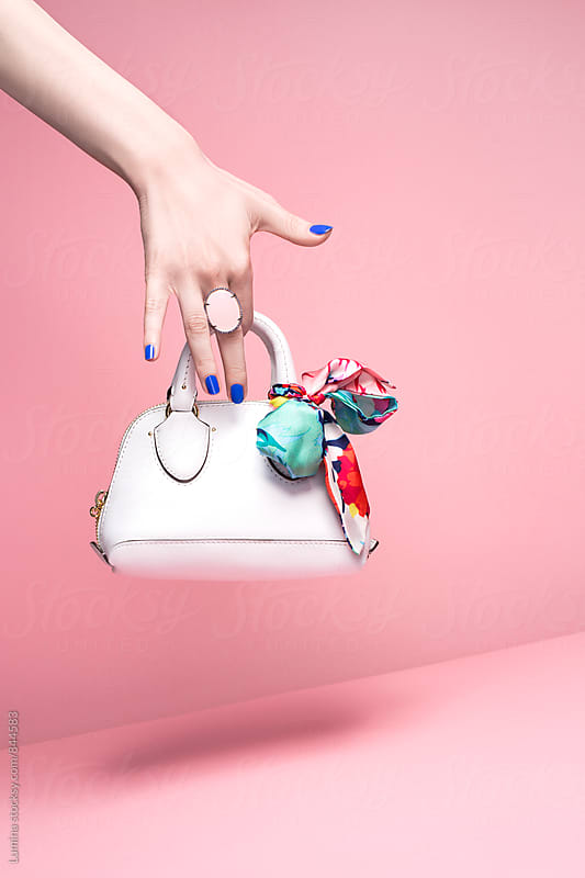 Hand of Woman Holding a Handbag by Lumina for Stocksy United