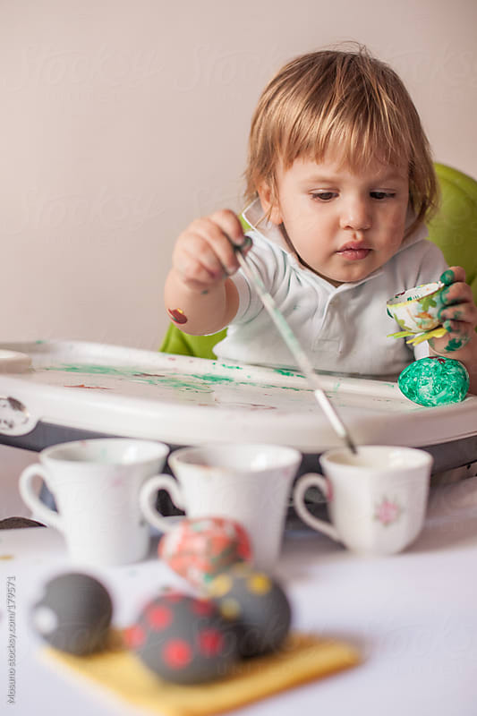 Little Boy Dyeing Easter Eggs by Mosuno for Stocksy United