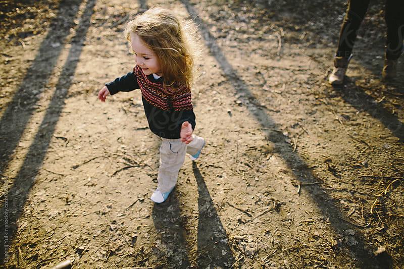 Little girl running in the rays of light by Evgenij Yulkin for Stocksy United
