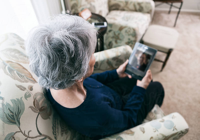 Senior: Focus On Silver Hair As Woman Video Chats by Sean Locke for Stocksy United