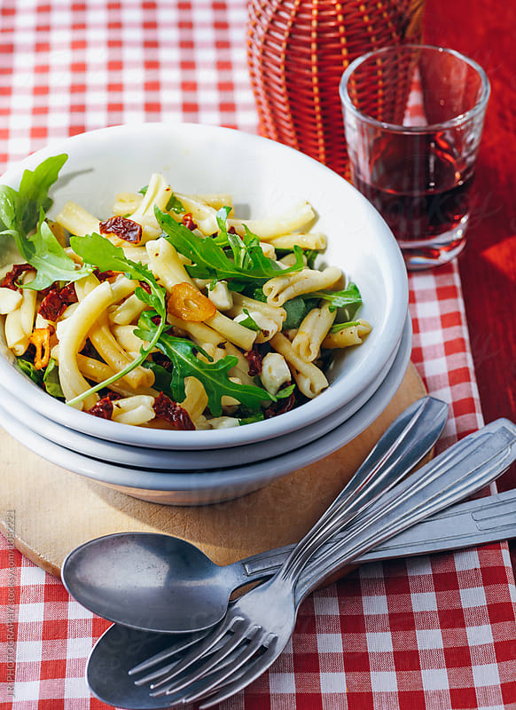 Pasta with rocket, tomato and garlic by J.R. PHOTOGRAPHY for Stocksy United