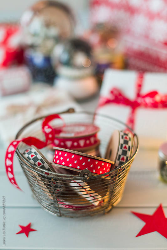 Stars and christmas trees patterned ribbons inside wire basket by Laura Stolfi for Stocksy United