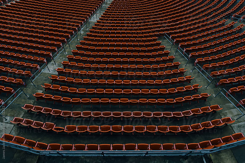 Looking down at empty seats of a stadium. by James Jackson for Stocksy United