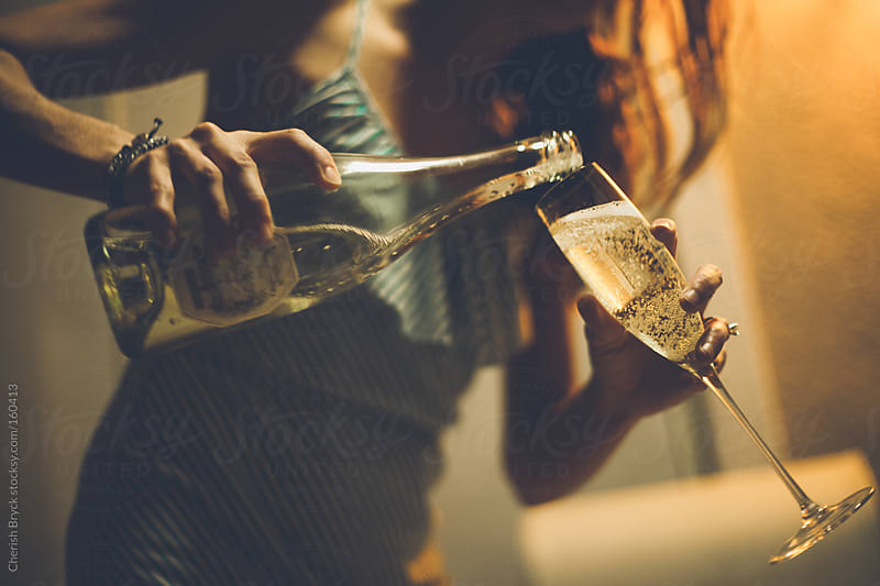 Time for champagne! by Cherish Bryck for Stocksy United