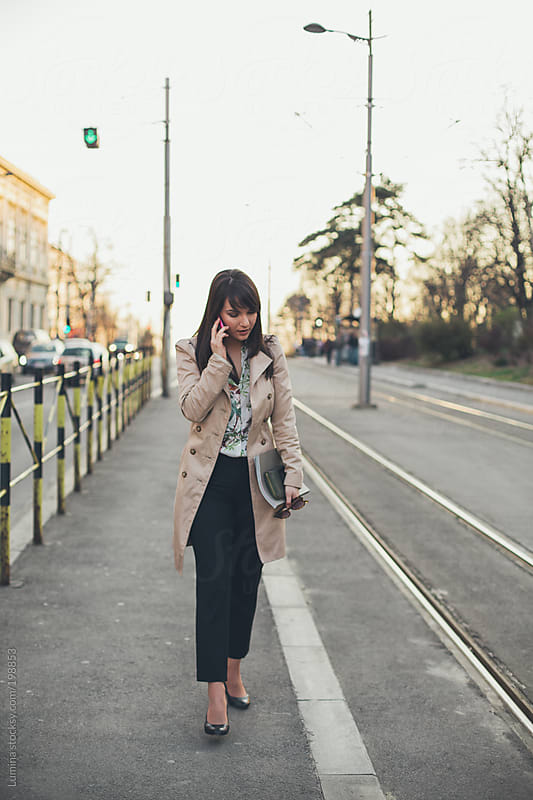 Businesswoman Telephoning on the Go by Lumina for Stocksy United