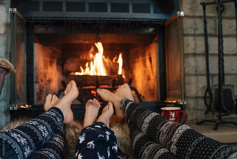 cozy fireplace by Melanie DeFazio for Stocksy United