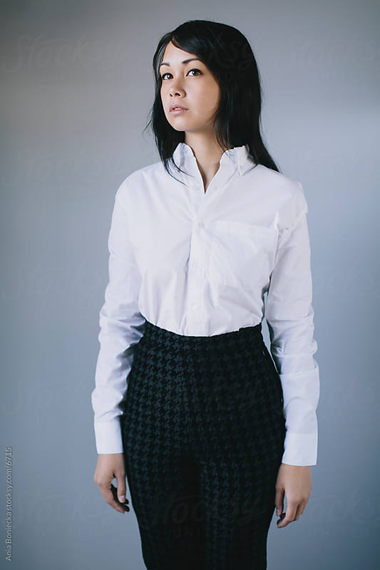A portrait of a young asian business woman by Ania Boniecka for Stocksy United