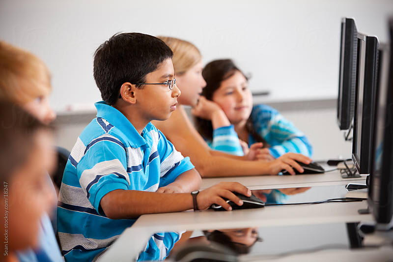 Computer Class: Students All Working Hard on Computer Lesson by Sean Locke for Stocksy United
