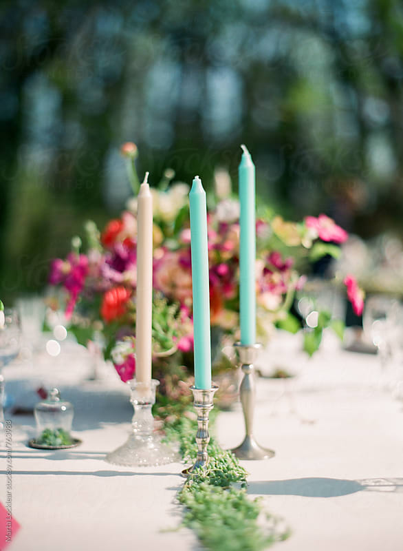 Candles on a formal dinner table by Marta Locklear for Stocksy United