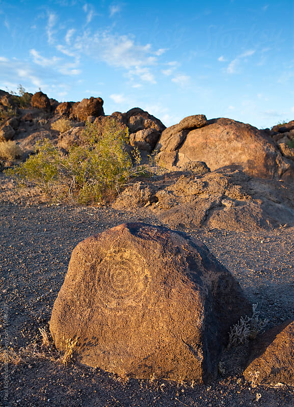 Native American rock art (petroglyph) carvings on rock formations, near Phoenix, AZ by Paul Edmondson for Stocksy United