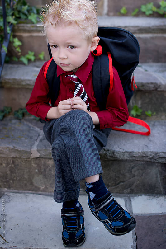 Apprehensive Little Boy on First Day Back to School by JP Danko for Stocksy United