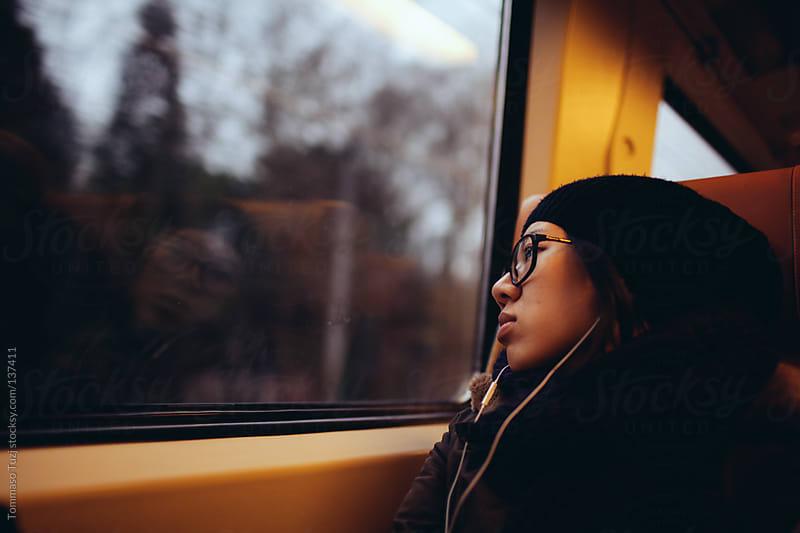 Girl listening to music by Tommaso Tuzj for Stocksy United