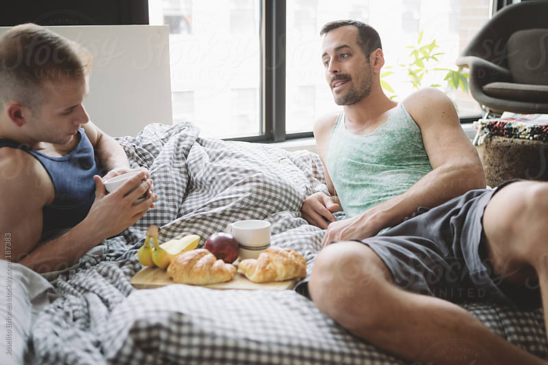 Gay Jock Lovers Having Breakfast in Bed by Joselito Briones for Stocksy United