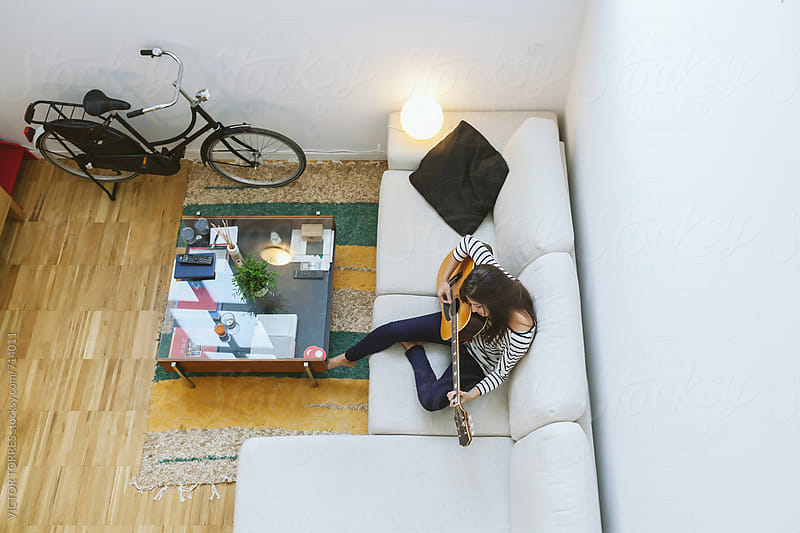 View from Above of Woman Playing Acoustic Guitar at Home by Victor Torres for Stocksy United