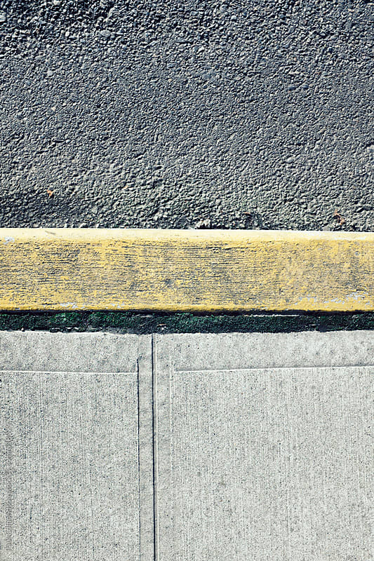 Painted curb along sidewalk and urban street by Paul Edmondson for Stocksy United