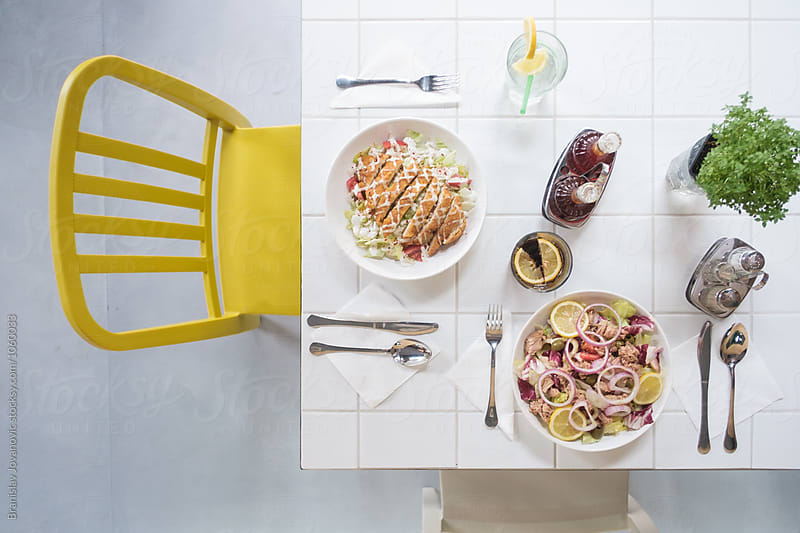Delicious Food on the Table at the Restaurant by Branislav Jovanović for Stocksy United