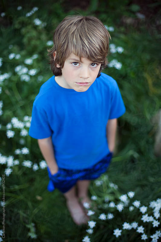 Portrait of deadpan seven year old boy by Carleton Photography for Stocksy United