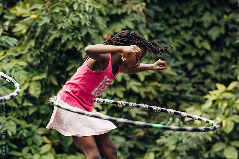 African American girl doing the hula-hoop by Gabriel (Gabi) Bucataru for Stocksy United