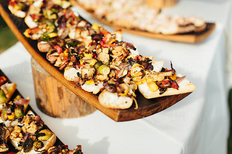 Delicious Open Faced Flatbread Sandwiches at an Event by B. Harvey for Stocksy United